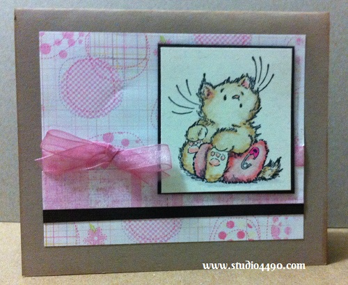 Baby Materials used: Stamp - Baby Kitty 1755H  (Penny Black); Tombow Markers; Cardstock - Bazzill Basics Paper; Designer Paper - Unknown; and Ribbon (Unknown).